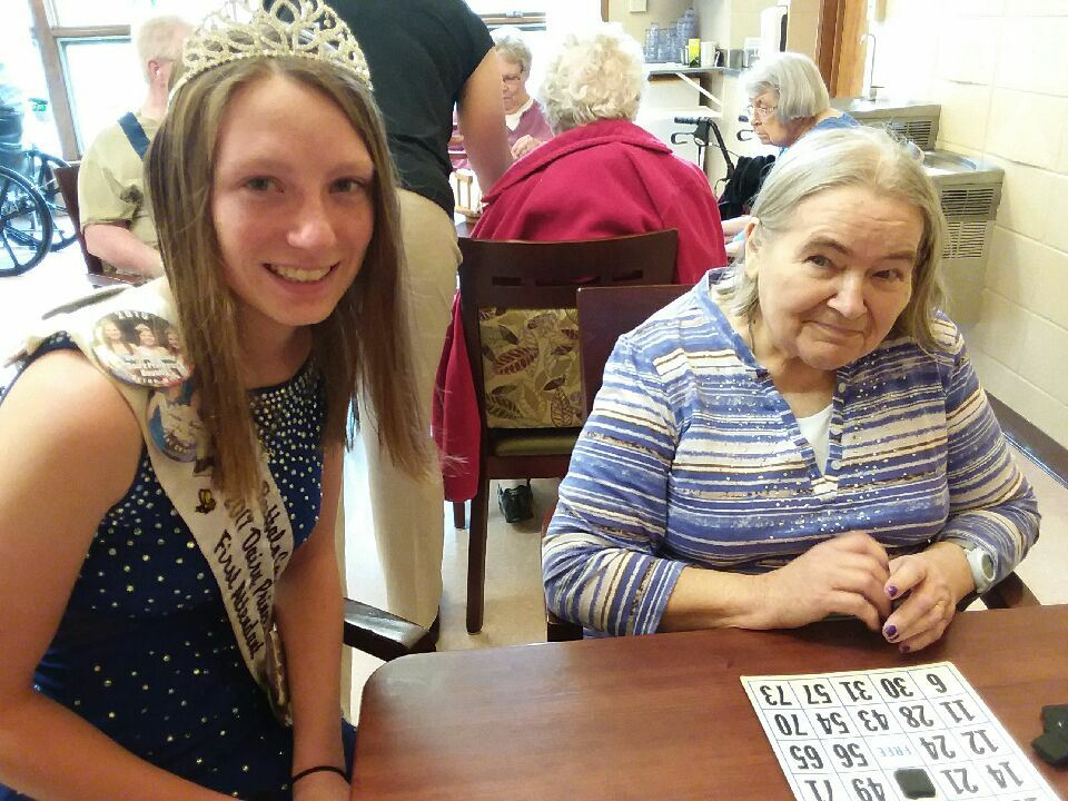 resident with queen playing bingo